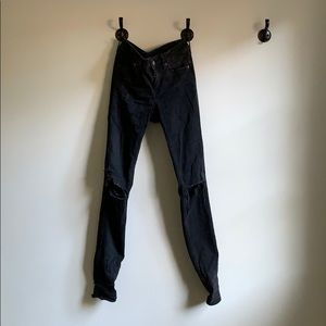 Low rise black destroyed jeans